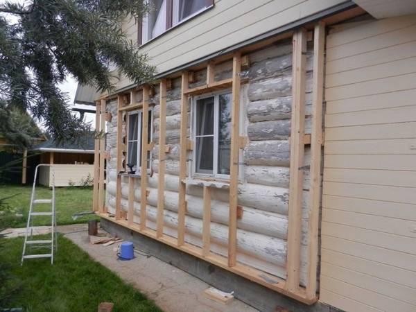 Искусственный камень для отделки фасада деревянного дома